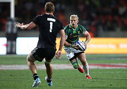 South African captain Kyle Brown on the attack during the Cup Final match between South Africa and New Zealand on Day 2 of the HSBC Sevens World Series Port Elizabeth Leg held at the Nelson Mandela Bay Stadium on 8th December 2013 in Port Elizabeth, South Africa. Photo by Shaun Roy/Sportzpics