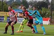 goalkeeper Bobby Olejnik and midfielder Arron Davies obstruct forward Jake Hyde from a corner during the Sky Bet League 2 match between Exeter City and York City at St James' Park, Exeter, England on 22 August 2015. Photo by Simon Davies.