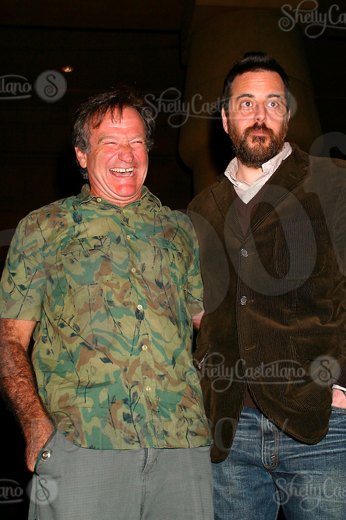 6 January 2003: Actor Robin Williams laughing standing beside writer/director Mark Romanek at the Egyptian Theatre on the red carpet for a screening of One Hour Photo. .