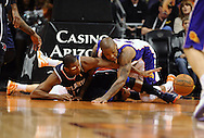 Mar. 1, 2013; Phoenix, AZ, USA; Atlanta Hawks center Al Horford (15) and Phoenix Suns forward P.J. Tucker (17) attempt to gain possession of the loose ball in the first half at US Airways Center. Mandatory Credit: Jennifer Stewart-USA TODAY Sports