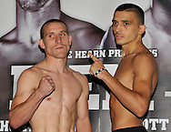 Picture by Alan Stanford/Focus Images Ltd +44 7915 056117<br />04/10/2013<br />Ryan Walsh and Lee Selby square up during Matchroom Sports weigh in at The O2 Arena, London.