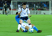 Scotland's Ross Wallace is tackled from behind by Daiki Iwamasa of Japan during their friendly international match in Yokohama, Japan on Saturday 10 Oct. 2009. Japan won 2-0..Photographer: Robert Gilhooly