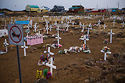 "A cemetery  in Iqaluit, Nunavut Territory, Canada. With a population of 6,000, Iqaluit is the largest community in Nunavut as well as the capital city, and is located in the southeast part of Baffin Island. Formerly known as Frobisher Bay, it is at the mouth of the bay of that name, overlooking Koojesse Inlet. ""Iqaluit"" means 'place of many fish'."