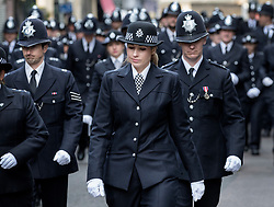 © Licensed to London News Pictures. 10/04/2017. London, UK. Officers follow the funeral cortege carrying the coffin of policeman Keith Palmer from Southwark after a service was held at the cathedral. PC Palmer was murdered just inside the main gates of Parliament by Westminster attacker Khalid Masood - an attack in which he also killed four people on Westminster Bridge. PC Palmer's funeral will take place at Southwark Cathedral today. Photo credit: Peter Macdiarmid/LNP
