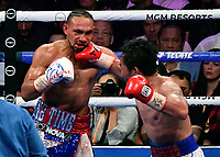 LAS VEGAS, NEVADA - JULY 20. <br /> Manny Pacquiao (R) hits Keith Thurman in the third round of their WBA welterweight title fight at MGM Grand Garden Arena on July 20, 2019 in Las Vegas, Nevada. Pacquiao took the win by a split decision.  (MB Media)