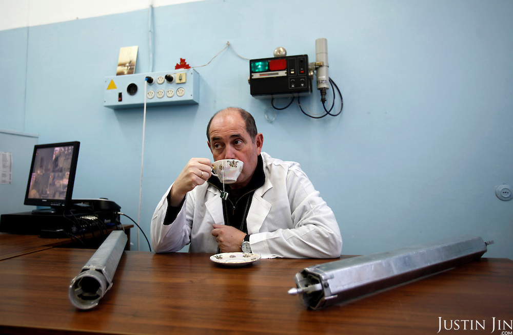American-Ukrainian physicist Igor Bolshinsky drinks tea inside the reactor while inspecting the transfer of highly enriched uranium into casks at the Institute of Nuclear Physics in Almaty, Kazakhstan. .The removal of Kazakhstan's highly enriched uranium (HEU) is part of the U.S. Global Threat Reduction Initiative (GTRI), where Bolshinsky works, that tries to secure nuclear material around the world to prevent their misuse by terrorists and rogue states.