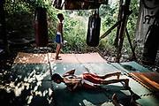 Bangkok, November 2 - 2013 Blood, sweat and tears: Muay Thai child fighters<br /> Many children are sent by parents from the rural regions in northeastern Thailand to Bangkok and other major cities to training camps in the hopes that their sons will become good fighters and be able to help the family financially.<br /> In Thai culture Muay Thai is a part of life and boys and girls train from an early age and it is not uncommon that children as young as these take part in tournaments in front of hundreds of spectators. Lumpinee Boxing Stadium / Petchsiam S.Thaweekan 13 Years OldBangkok, 2 novembre - 2013 Sang, sueur et larmes : Muay Thai enfants combattants<br /> De nombreux enfants sont envoy&eacute;s par des parents des r&eacute;gions rurales du nord-est de la Tha&iuml;lande &agrave; Bangkok et dans d'autres grandes villes dans des camps d'entra&icirc;nement dans l'espoir que leurs fils deviennent de bons combattants et puissent aider financi&egrave;rement la famille.<br /> Dans la culture tha&iuml;landaise, le Muay Thai fait partie de la vie et les gar&ccedil;ons et les filles s'entra&icirc;nent d&egrave;s leur plus jeune &acirc;ge et il n'est pas rare que des enfants aussi jeunes que ceux-ci participent &agrave; des tournois devant des centaines de spectateurs. Lumpinee Boxing Stadium / Petchsiam S.Thaweekan 13 ans