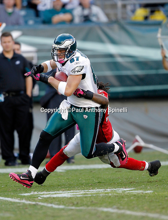 Philadelphia Eagles tight end Brent Celek (87) catches a late fourth quarter pass while being tackled by Atlanta Falcons linebacker Mike Peterson (53) during the NFL week 6 football game against the Atlanta Falcons on Sunday, October 17, 2010 in Philadelphia, Pennsylvania. The Eagles won the game 31-17. (©Paul Anthony Spinelli)