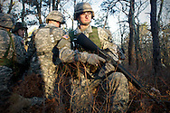 April 9, 2011, Camp Edwards, MA - Cadet Jon Broderick forms one part of a 360 degree security perimeter of his squadron's position during a field training exercise. Broderick plans to become an Infantry Patrol Leader when he graduates and is commissioned in the United States Army. Photo by Lathan Goumas.