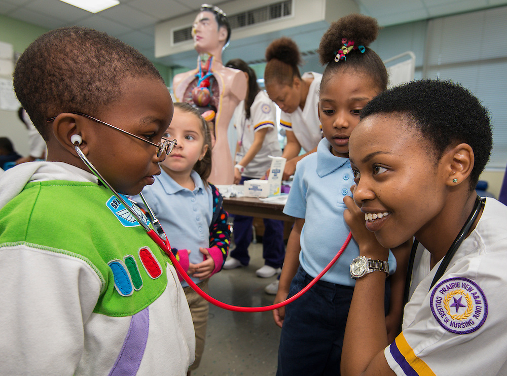 Nursing students from Prairie View A&M University College of Nursing teach Pre-K students about nutrition and digestion at Whidby Elementary School, November 21, 2013.