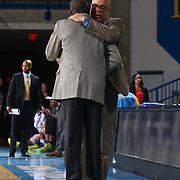 Delaware 87ers Head Coach Rod Baker and Springfield Armor Head Coach Doug Overton embrace at the end of a NBA D-league regular season basketball game between the Delaware 87ers (76ers) and Springfield Armor (Brooklyn Nets) Saturday, Apr. 05, 2014 at The Bob Carpenter Sports Convocation Center, Newark, DEL.
