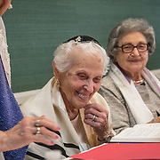 CHEVY CHASE, MD -MAY14: (L-R)Charlotte Gottlieb, 93, Charlotte Markowitz, 85, and Sy Laufe, 90, are all smiles after they read from the Torah at their Bat-Mitzvah ceremony, at the Five Star Residences in Chevy Chase, Maryland, May 14, 2016. The women who were unable to have a Bat-Mitzvah ceremony at the traditional age of 13 because they were girls, are now finally able to celebrate this traditional Jewish coming of age ceremony. (Photo by Evelyn Hockstein/For The Washington Post)