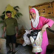 17th August 2006&#xA;Nabatieh, Lebanon&#xA;Post War South Lebanon&#xA;The home of Ibrahim Atwe and his wife Hiam Safa was devastated by Israeli airstrikes. They have begun to clean up but are awaiting the promised assitance of Hezbollah who have sated the will help fund the recontruction of the homes damaged or lost in the recent conflict.<br />