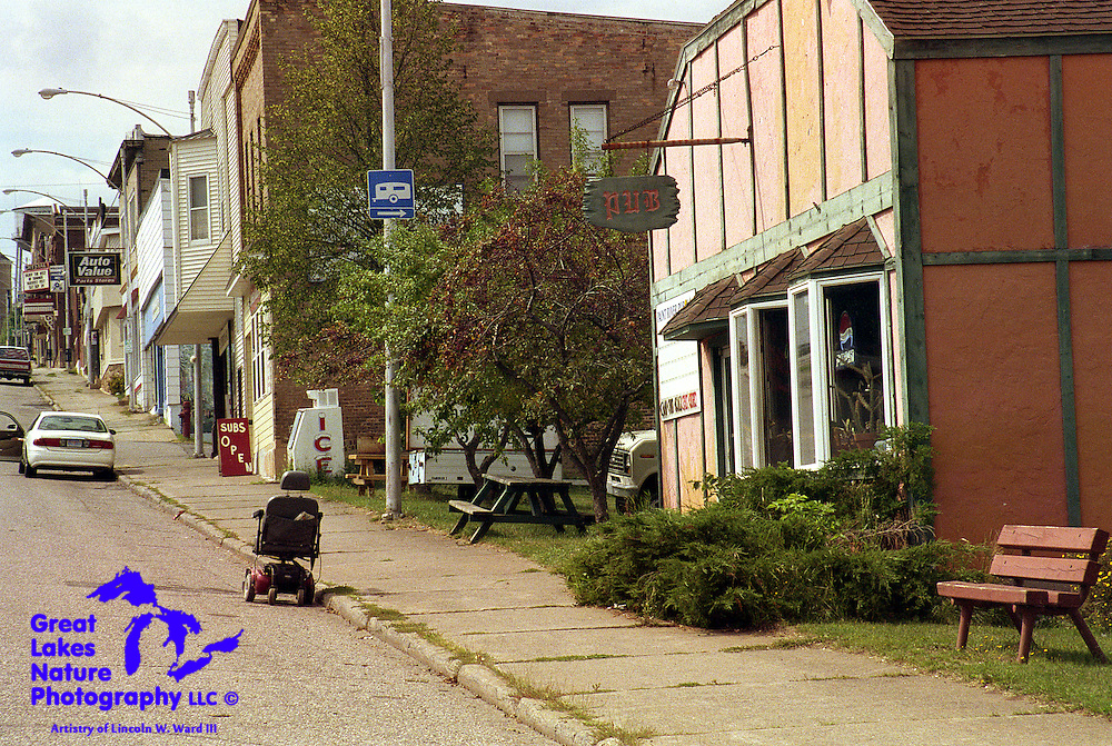 A tavern patron in Crystal Falls, Michigan, has parked his vehicle in an ordinary parallel parking space, where you might expect to find cars, pickups, or snowmobiles. Perhaps his need to get to the pub was urgent, and the John Deere wouldn't start....