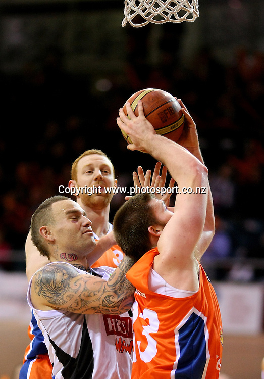 Brian Conklin of the Sharks takes a shot while defended by Sam Walker of the Hawks in the NBL national basketball league, Zero Fees Southland Sharks v HBS Bank Hawks, Stadium Southland Velodrome, Invercargill, New Zealand, Saturday, May 25, 2013. Photo:  Dianne Manson / photosport.co.nz