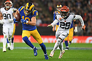 LA Rams Wide Receiver Cooper Kupp (18) runs the ball chased by Cincinnati Bengals Defensive Back Tony McRae (29) during the International Series match between Los Angeles Rams and Cincinnati Bengals at Wembley Stadium, London, England on 27 October 2019.