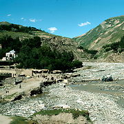 21 May 1976<br /> Faizabad (Blessed Abode) takes its name from the fact that in 1691 the Cloak of the Prophet Mohammad was brought here by one of a long list of local chieftains competing to rule various parts of the Badakhshan territory until 1889 when Amir Abdur Rahman annexed it by force. it is notes by famous travellers as early as the 5th century as a lucrative trade route between China and the India Subcontinent.<br /> The river divides the two sections of the present capital of Badakhshan Province Orchards and houses in the north section on the left and orchards of the south section on a terrace on the right. Lalmi (un-irrigated plots)on hill to right.