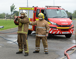 Pictured: Watch Manager Paul Halliday and Crew Manager Tony Reid with the new firefighting lance.<br /> <br /> The Scottish Fire & Rescue Service unveiled it's latest weapon in firefighting, an ultra high pressure lance that allows firefighters to put out  fires more quickly using less water, and without having to enter the building. It is part of a £7.6 million GBP investment in 40 new smaller fire appliances that will enter service over the coming months, and will primarily be stationed in rural communities.<br /> <br /> © Dave Johnston/ EEm