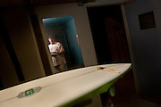 """Surfboard shaper Mike Mooney at his shop in Ventura Calif., on Tuesday, Mar. 14, 2012.  Nowadays, Mooney has gone back to his roots, ever since the city closed down this shop after citing building code violations.  The closure forced him  into semi-retirement, but he still shapes in select """"secret spots"""" across Ventura.  (Photo by Aaron Schmidt © 2012)"""