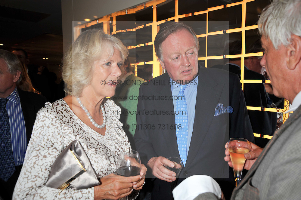 Left to right, HRH The DUCHESS OF CORNWALL, her ex husband ANDREW PARKER BOWLES and NICKY HASLAM at the launch of Tom Parker Bowles's new book 'Full English' held in the Gallery Restaurant, Selfridges, Oxford Street, London on 9th September 2009.