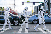 """Members of the 501st Legion, an all-volunteer organization that promotes interest in """"Star Wars"""" while appearing at local community and charity events, check out the EMP Museum's sci-fi exhibit while wearing their storm-trooper outfits. (Johnny Andrews / The Seattle Times)"""