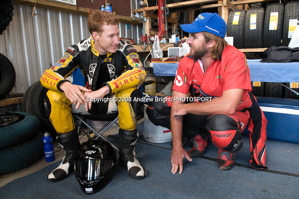 Australian riders Gareth Jones L and Joel Reed R discuss racing lines ahead of their Superbike races at Wanganui's Cemetery Circuit on Boxing Day.