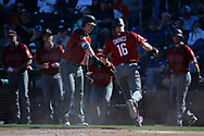 SURPRISE, AZ - MARCH 06:  Chris Owings #16 of the Arizona Diamondbacks is congratuled by Chris Herrmann #10 after scoring in the sixth ining against the Kansas City Royals in the spring training game at Surprise Stadium on March 6, 2017 in Surprise, Arizona.  (Photo by Jennifer Stewart/Getty Images)