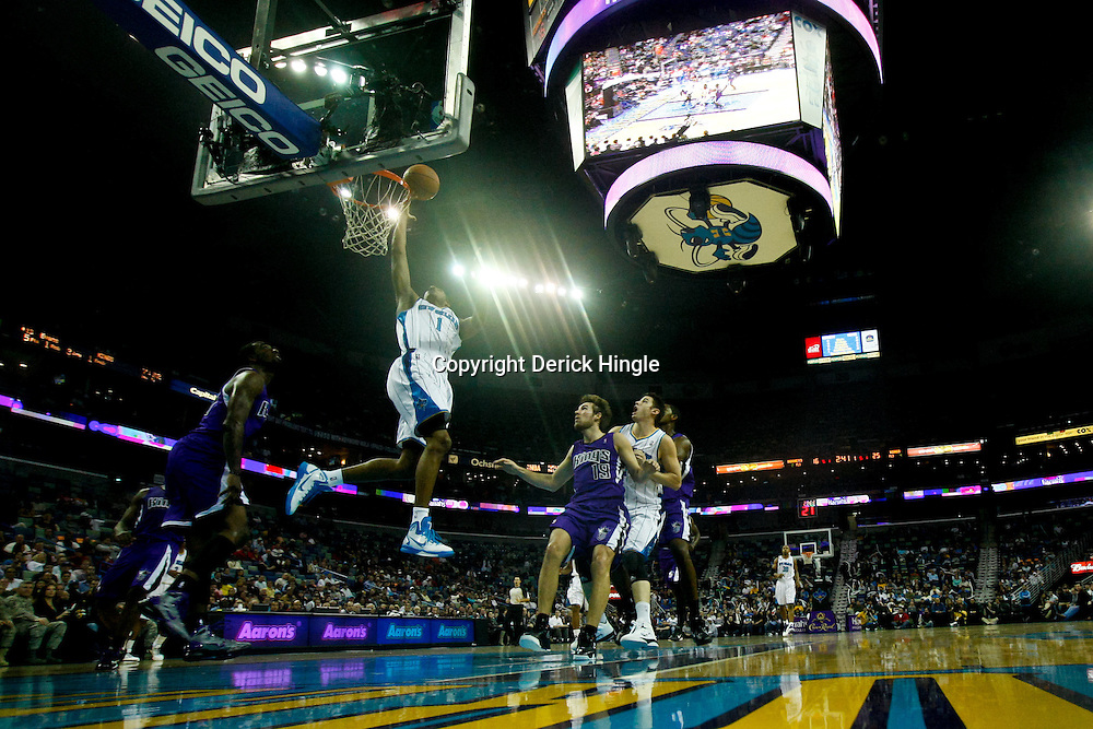 December 15, 2010; New Orleans Hornets small forward Trevor Ariza (1) shoots against the Sacramento Kings during the first half at the New Orleans Arena. The Hornets defeated the Kings 94-91. Mandatory Credit: Derick E. Hingle