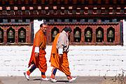 Two men wearing traditional clothing in Paro, Bhutan