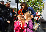 Nathan Ake (5) of AFC Bournemouth has a photo with two young fans on arrival before the Premier League match between Bournemouth and Tottenham Hotspur at the Vitality Stadium, Bournemouth, England on 4 May 2019.