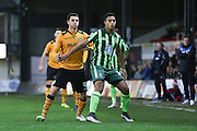 Lyle Taylor of AFC Wimbledon and Tommy O'Sullivan of Newport County during the Sky Bet League 2 match between Newport County and AFC Wimbledon at Rodney Parade, Newport, Wales on 19 December 2015. Photo by Stuart Butcher.