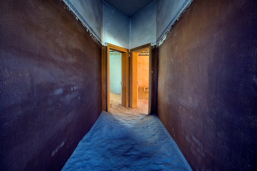 Looking down the hallway of an abandoned house, Kolmanskop, Namibia.