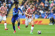 Leicester City midfielder Wilfred Ndidi (25) chases down Stoke City midfielder Ramadan (32) during the Premier League match between Leicester City and Stoke City at the King Power Stadium, Leicester, England on 1 April 2017. Photo by Jon Hobley.