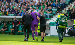 Alloa Athletic's keeper Neil Parry goes off injured after the collision with Hibernian's Christian Doidge for their first goal. Hibernian 2 v 0 Alloa Athletic, Betfred Cup game played Saturday 20th July at Easter Road, Edinburgh.
