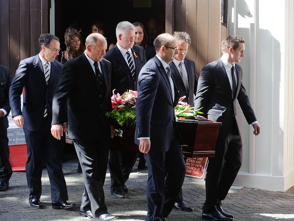 Former All Balck rugby captain Michael James Bowie (Jock) Hobbs' coffin is carried from Old St Pauls Church by  Rob Morrison, left, Steve Tew, Don Hayes, Rob Deans, Peter Hobbs, Michael Hobbs, Wellington, New Zealand, March 18, 2012. Credit: SNPA / Mark Coote