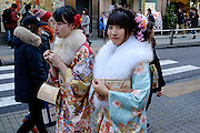 JANUARY 09: Japanese women who celebrate turning 20 years old, clad in Japanese kimono in shibuya, Tokyo, on Coming of Age Day national holiday, Monday, Jan. 9, 2017. While many festive ceremonies are held in various venues throughout Japan, The day is marked by those who turned 20 in the past year after April 1 or will be 20 before March 31 this year. 09/01/2017-Tokyo, JAPAN