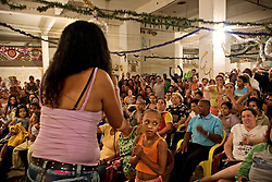 Ivaneti de Araujo, one of the most important leader of the Downtown Roofless Movement (Movimento dos Sem Teto do Centro), informing Prestes Maia families about a new suspend of the eviction at the Prestes Maia Genereal Assembly. They won more two months to stay (February, 2006).