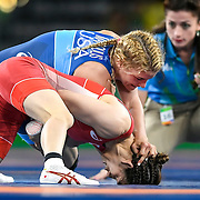 Helen Maroulis, top, in blue, earned the United States its first Olympic gold in women's wrestling, defeating three-time Olympic champion Saori Yoshida of Japan Thursday evening at Carioca Arena 2 during the 2016 Summer Olympics Games in Rio de Janeiro, Brazil.