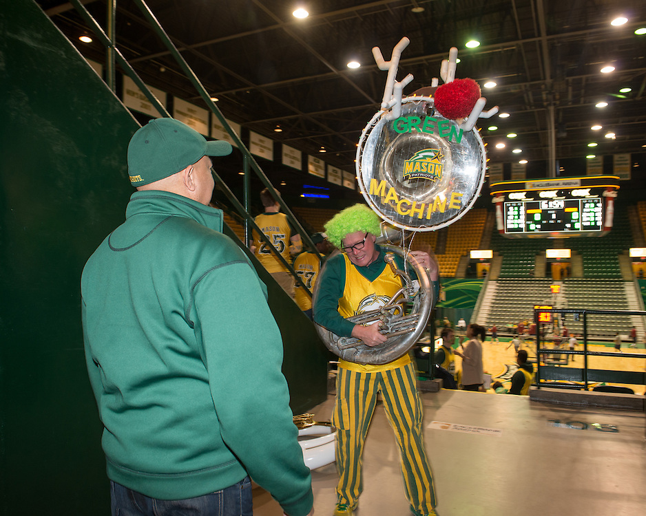 December 5, 2015 - Fairfax, VA - A day in the life of &quot;Doc Nix,&quot; aka Dr. Michael Nickens, the Director of the Athletic Bands for George Mason University. Here booster John Hanks models his holiday themed tuba.<br /> <br /> Photo by Susana Raab