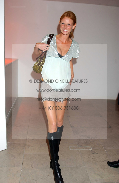 Model OLIVIA INGE at a cocktail party hosted by MAC cosmetics to kick off London Fashion Week at The Hospital, 22 Endell Street London on 18th September 2005.At the event, top model Linda Evangelista presented Ken Livingston the Lord Mayor of London with a cheque for £100,000 in aid of the Loomba Trust that aims to privide education to orphaned children through a natural disaster or through HIV/AIDS.<br /><br />NON EXCLUSIVE - WORLD RIGHTS