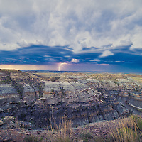 montana badlands lighting and huge storm clouds over badlands