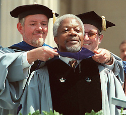 United Nations Secretary General Kofi Annan (C) is dressed in his graduate gown by Columbia University faculty members as he is awarded an honorary degree 20 May in New York. Annan was honored by Columbia with a Doctorate of Law during the Commencement ceremony for some 9,000 Columbia University graduates.