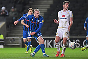 Rochdale midfielder Stephen Dooley (7) takes a shot at goal during the EFL Sky Bet League 1 match between Milton Keynes Dons and Rochdale at stadium:mk, Milton Keynes, England on 28 January 2020.