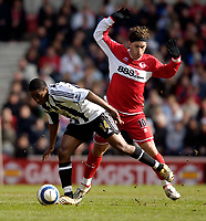Photo: Jed Wee.<br /> Middlesbrough v Newcastle United. The Barclays Premiership. 09/04/2006.<br /> <br /> Middlesbrough's Fabio Rochemback (R) tries to stop Newcastle's Charles N'Zogbia.
