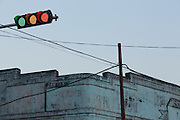 Green, Yellow, Red traffic light with Colonial building rooftop, Pyay