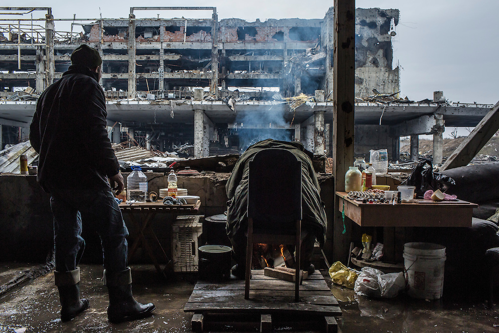 Russian-backed rebels stationed are stationed in a parking garage with a view of the destroyed terminal of the Donetsk Airport on Tuesday, March 22, 2016 in Donetsk, Ukraine.