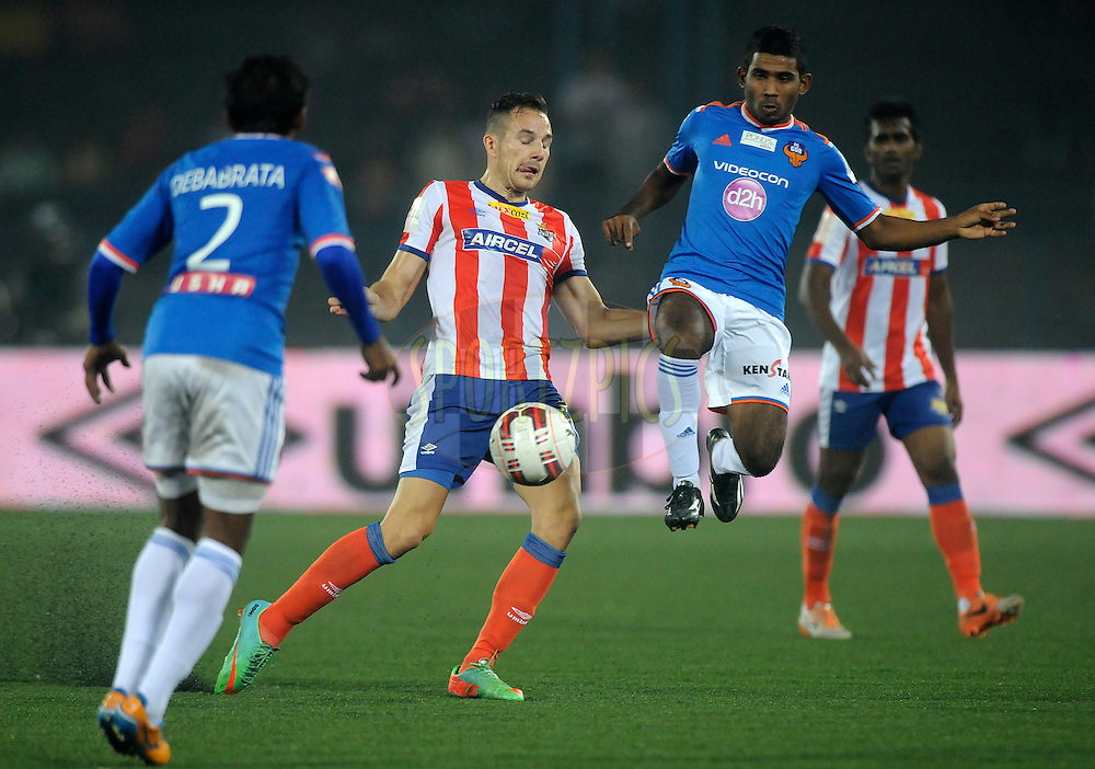 Jakub Podany of Atletico de Kolkata and Gabriel Fernandes of FC Goa during match 55 of the Hero Indian Super League between AtlŽtico de Kolkata and FC Goa held at the Salt Lake Stadium in Kolkata, West Bengal, India on the 10th December 2014.<br /> <br /> Photo by:  Pal Pillai/ ISL/ SPORTZPICS