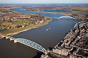 Nederland, Gelderland, Nijmegen, 07-03-2010; Waal met Waalbrug, rechts de binnenstad, links het dorp Lent. Waalsprong: aan de noordoever van de Waal, rond het dorp Lent zal een nieuw stadsdeel gebouwd gaan worden; ook wordt op deze lokatie een geul uitgegraven, meer landinwaarts ten opzicht van de rivier, om de rivier meer de ruimte te geven, Lent (aan de dijk) komt dan op een eiland te liggen..River Waal with Waal bridge, right inner city, left the village of Lent. Waalsprong (jump): on the north bank of the river, around the village of Lent, a new district will be build. And a flood trench will be dug (more inland) to give the river more space. Lent (at the dike) will be located on an island..luchtfoto (toeslag), aerial photo (additional fee required).foto/photo Siebe Swart