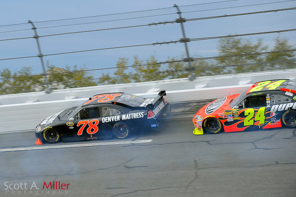 Feb. 11, 2010; Daytona Beach, FL, USA; NASCAR Sprint Cup Series driver Regan Smith (78) leaves paint on the wall in turn 4 after being hit from behind by Jeff Gordan (24) during race one of the Gatorade Duel at Daytona International Speedway. ©2010 Scott A. Miller