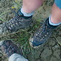 famous missiouri river gumbo caked on the boots of two hikers after a rain squwal in the umrbnm
